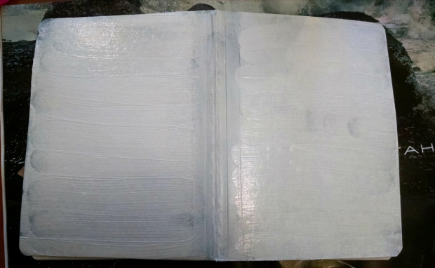 Cover the entire front and back cover with Gesso and Let dry.