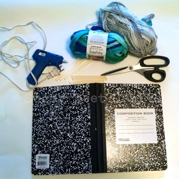 yarn, scissors, glue gun & sticks, notebook