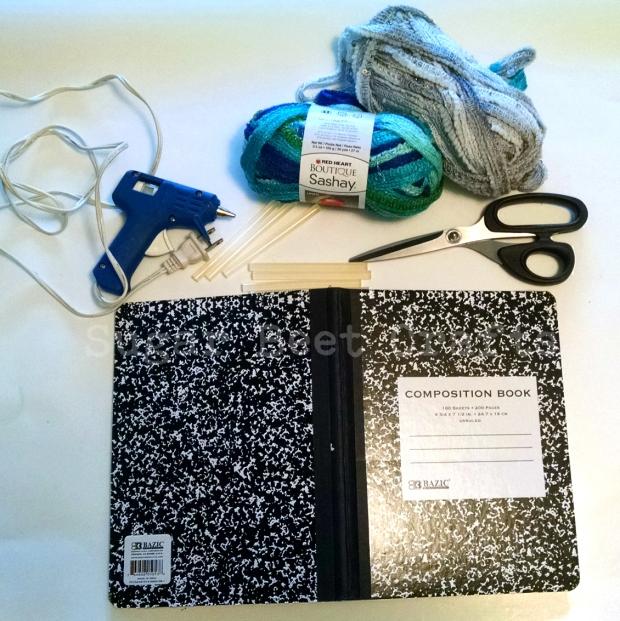 yarn, scissors, glue gun & sticks, notebook